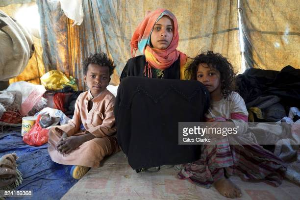 APRIL Ibtissam a 15yearold orphan girl lives in a ragged tent with her 7 siblings in an IDP settlement in Khamir about 100 km north of the capital...