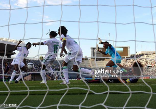 Ibubeleye Whyte goalkeeper of Nigeria makes a save on Nozomi Fujita of Japan during the FIFA U20 Women's World Cup Japan 2012 Third place match...