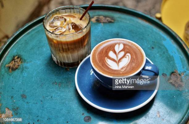 ice and hot cafe latte - caffeine stock pictures, royalty-free photos & images