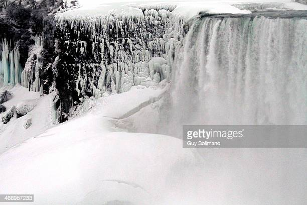 Ice and snow forms on the Niagara River in front of Niagara Falls on February 5, 2014 in Niagara Falls, New York. An additional foot of snow...