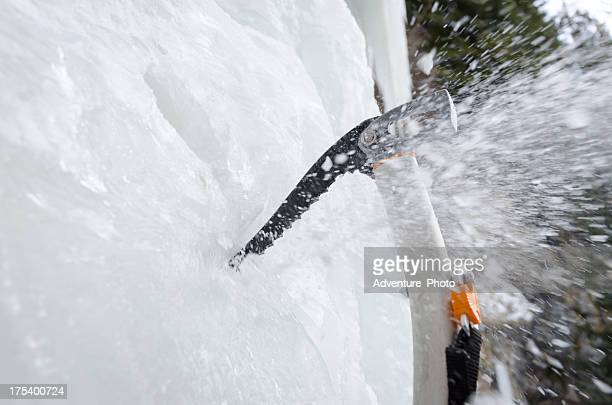 Ice Axe Penetrating and Shattering Frozen Waterfall