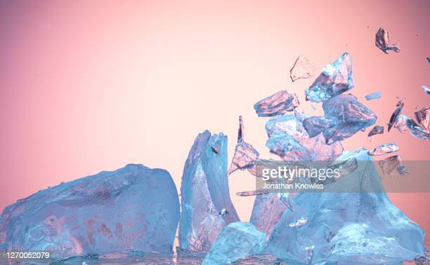 ice block exploding - ice stock pictures, royalty-free photos & images