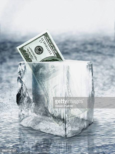 Ice block with one hundred dollar US bill