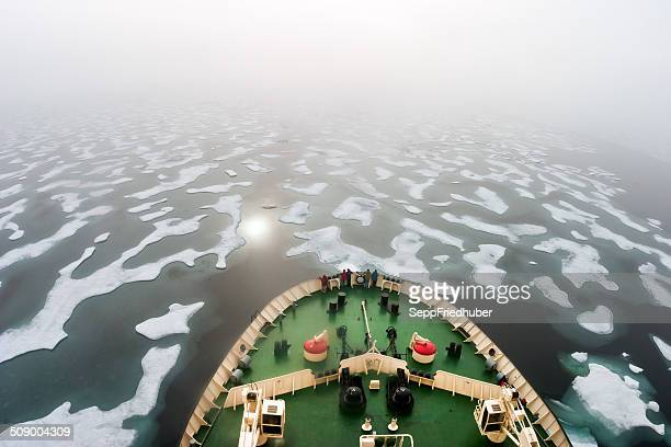 Ice breaker heading in the fogy NE Passage Russia