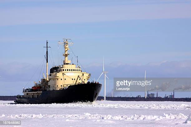 ice breaker ploughing the icefield, wind turbines in arctic environment