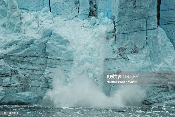Ice Breaking From A Glacier