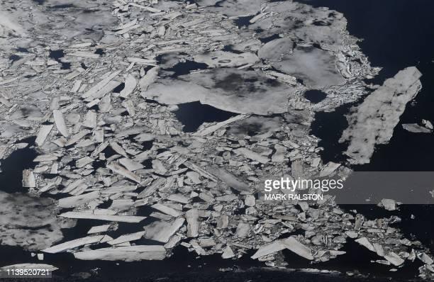 Ice breaks up early on the Kuskokwim River beside the Bering Sea and near the climate change affected Yupik Eskimo village of Quinhagak on the Yukon...
