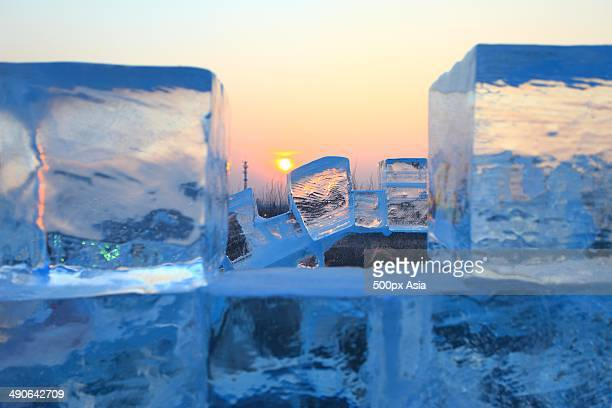 ice bricks, sunrise,harbin ice and snow wonderland - harbin winter stock pictures, royalty-free photos & images