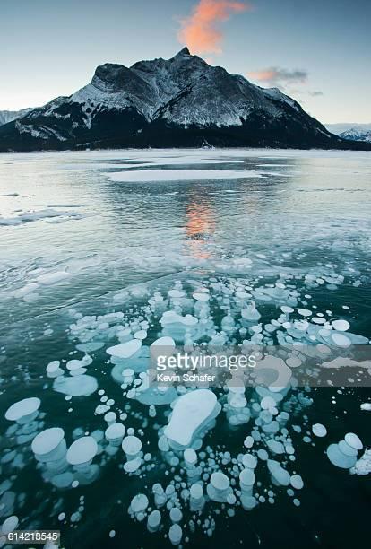 'Ice Bubbles' in frozen lake, Alberta
