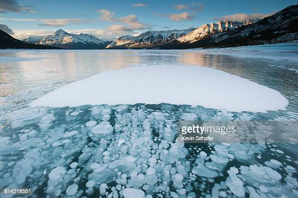 'Ice Bubbles' in frozen lake, Alberta