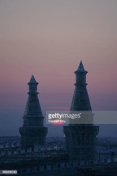 Ice buildings are displayed under sunset at the Grand Ice and Snow World part of the 22nd Harbin International Ice and Snow Festival on January 10...
