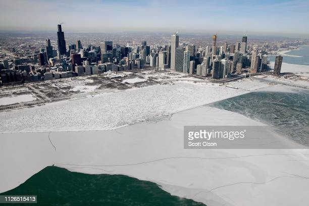 Ice builds up along the shore of Lake Michigan as temperatures during the past two days have dipped to lows around 20 degrees on January 31 2019 in...