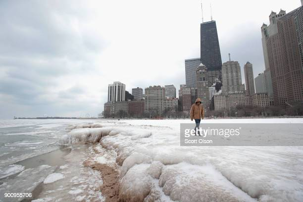 Ice builds up along the shore of Lake Michigan on January 3 2018 in Chicago Illinois Record cold temperatures are gripping much of the US and are...