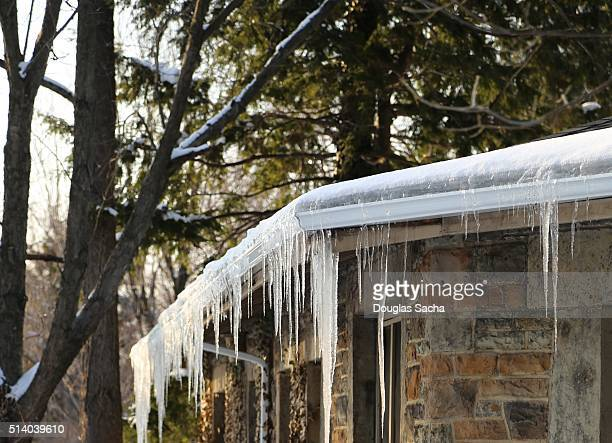 Ice builds up on the building roof and gutters causing icicles