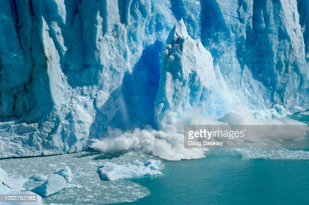 ice calving off glacier perito moreno in los glaciares national park, el calafate, argentina. - glacier collapsing stock pictures, royalty-free photos & images