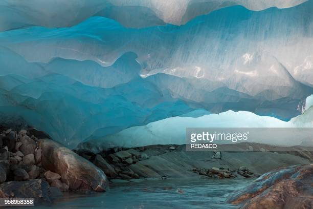 Ice cave and glacier snout of Schlatenkees source of the creek Schlatenbach parts of the have collapsed and melted away Therefore an ice cave with...