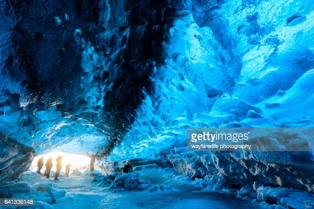 ice cave glacier and group of tourists, iceland - skaftafell national park stock photos and pictures