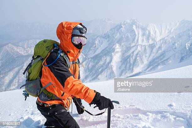 ice climber making his way through the snow - tottori prefecture stock photos and pictures