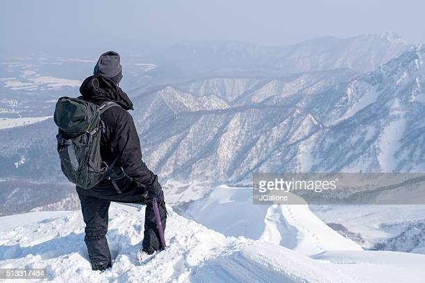 Ice Climber on the Mountains Summit