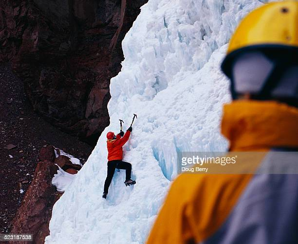 Ice Climber Reaching for a Hold
