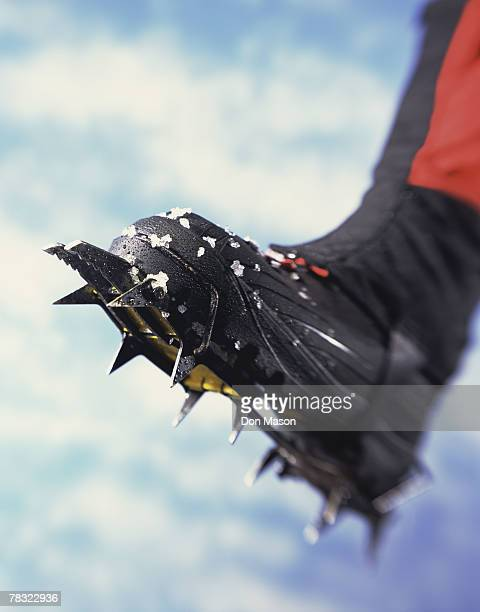 Ice climbing boot and spiky crampon