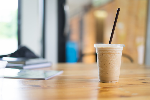 Ice coffeeon working space background and bokeh - gettyimageskorea