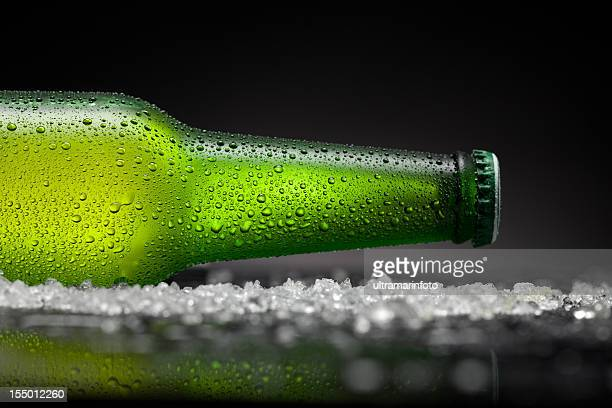 ice cold  beer bottle - beer bottle stock pictures, royalty-free photos & images