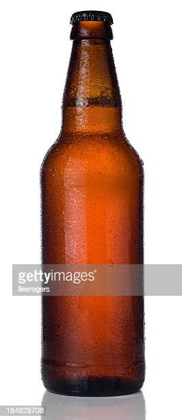 ice cold bottle of beer isolated on a white background - ale stock pictures, royalty-free photos & images