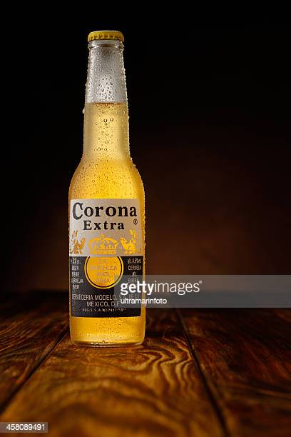 ice cold bottle of corona beer - corona beer stock pictures, royalty-free photos & images