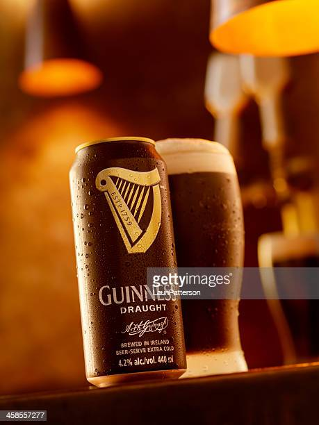 ice cold can and pint of guinness beer - guinness stock photos and pictures