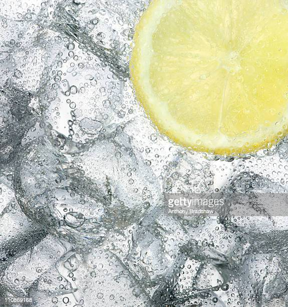 Ice cold drink with a slice of lemon