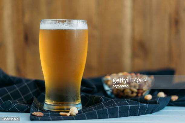 ice cold glass of beer - pilsner stock photos and pictures