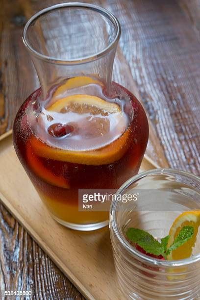 Ice Cold Glass of Raspberry Iced Tea Over Ice Cubes