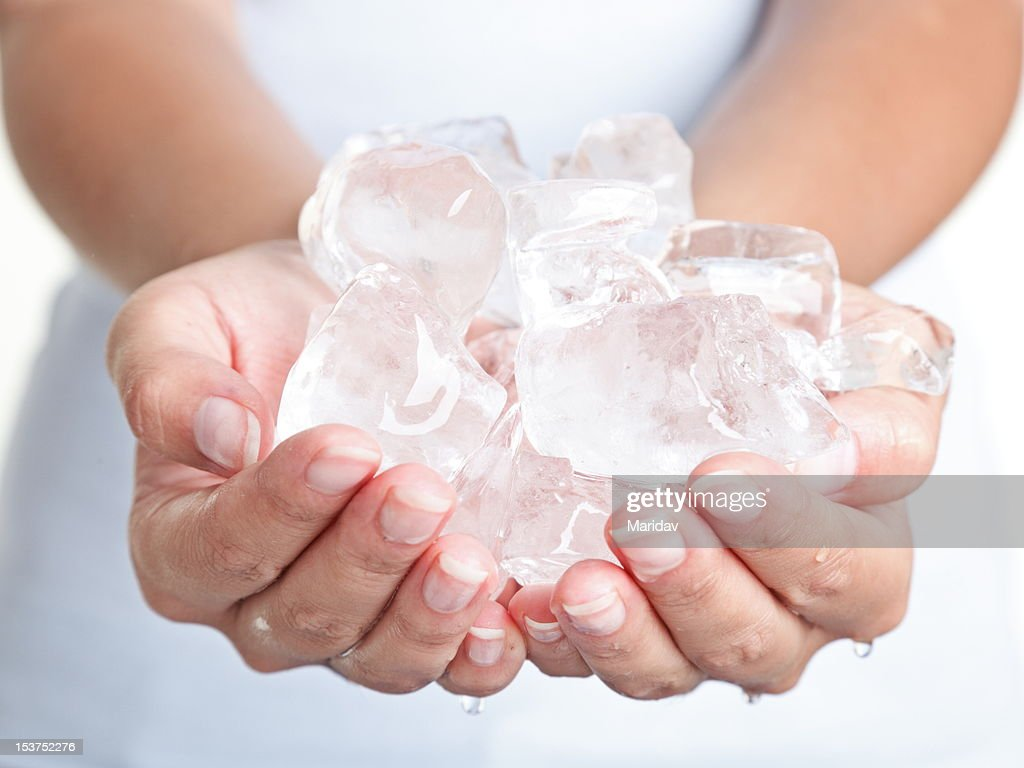 Ice cold hands : Stock Photo