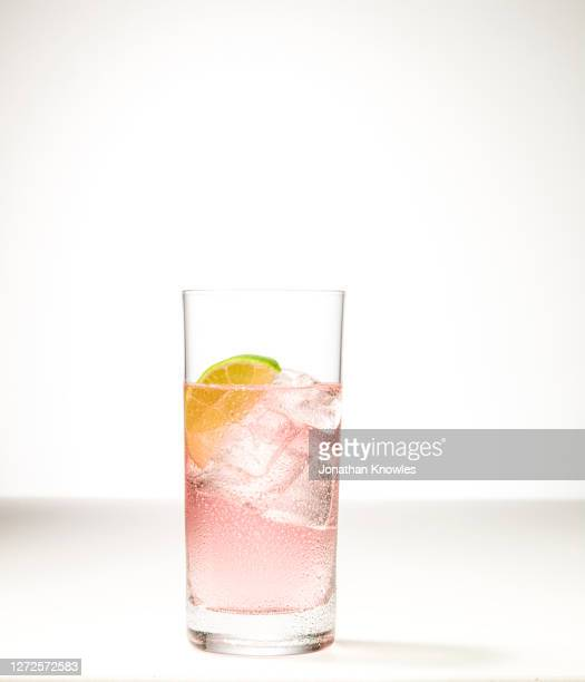 ice cold, pink lime drink - pink colour stock pictures, royalty-free photos & images