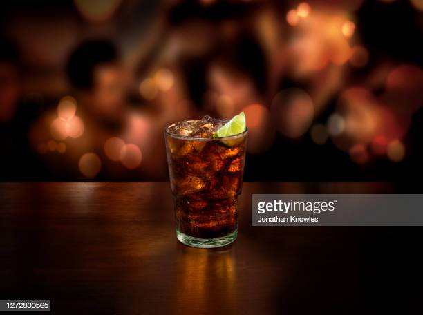 ice cold rum and coke - close up stock pictures, royalty-free photos & images
