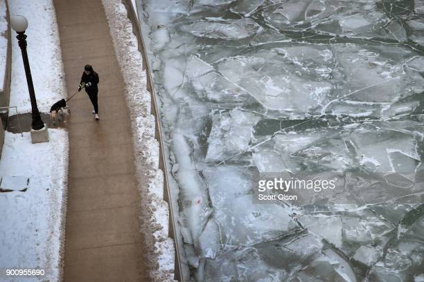 Ice collects on the Chicago river on January 3 2018 in Chicago Illinois Record cold temperatures are gripping much of the US and are being blamed on...