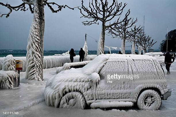 Ice covered car and trees in Versoix
