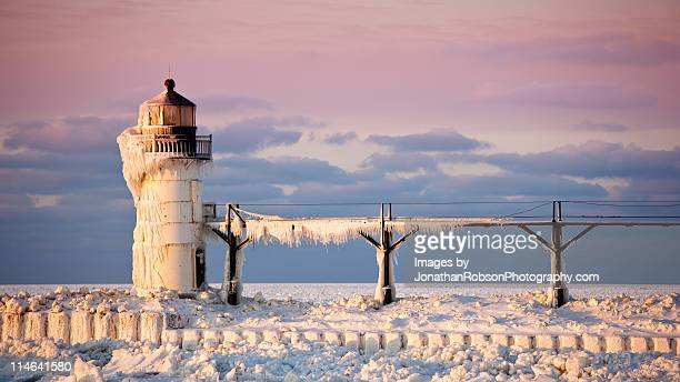 Ice covered michigan lake lighthouse