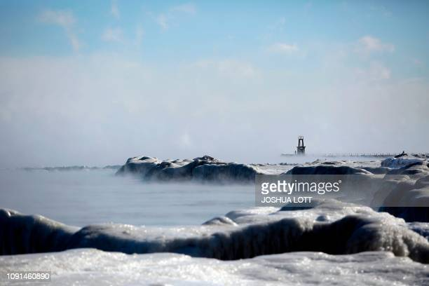 TOPSHOT Ice covers Lake Michigan's shoreline as temperatures dropped to 20 degrees F on January 30 2019 in Chicago Illinois Frostbite warnings were...
