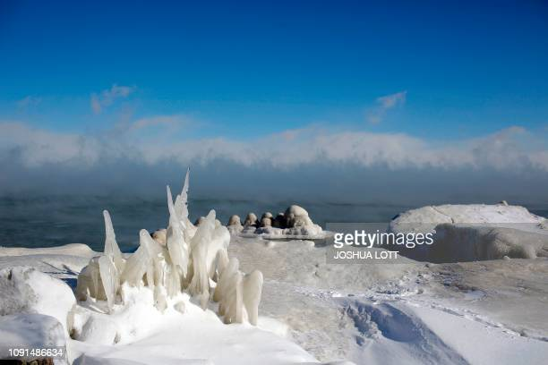 Ice covers Lake Michigan's shoreline as temperatures dropped to 20 degrees F on January 30 2019 in Chicago Illinois Frostbite warnings were issued...