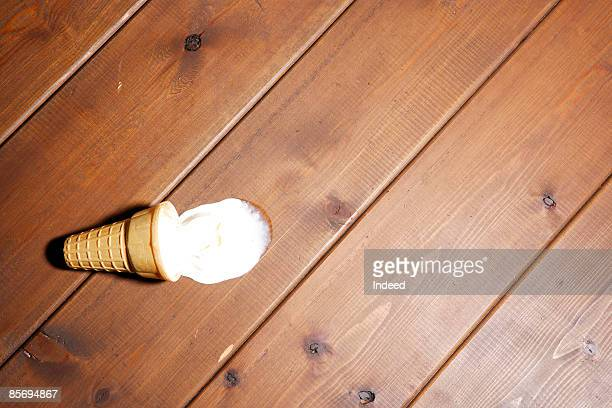 Ice cream and cone on floor
