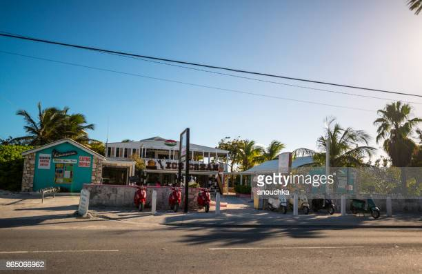 ice cream and scooter rental near the regent village, turks and caicos islands - grand bahama stock photos and pictures