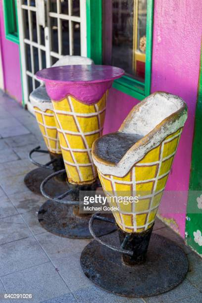 Ice cream cone shaped stools and table outside an ice cream shop