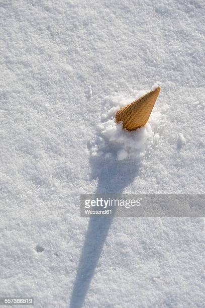 ice cream cone sticking in snow - irony stock pictures, royalty-free photos & images