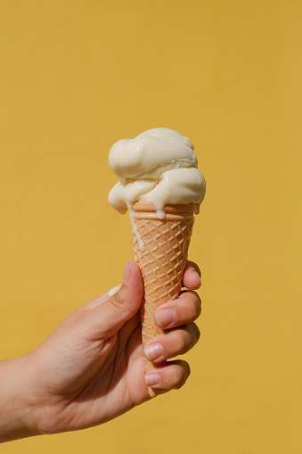 Ice cream cones against a yellow wall - gettyimageskorea