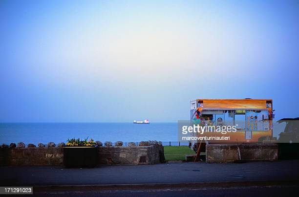 Ice cream kiosk at the sea, evening