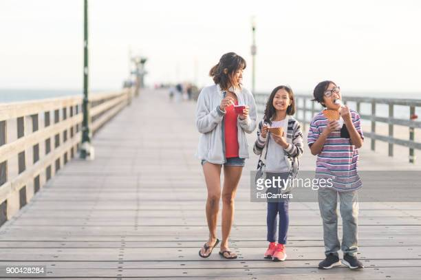 ice cream on the boardwalk! - filipino family eating stock pictures, royalty-free photos & images