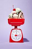 scoops ice cream piled onto food