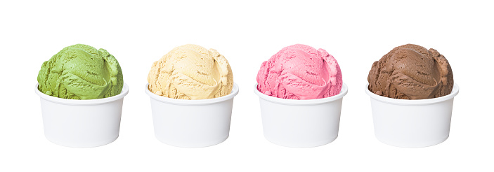 Ice cream scoops in white cups of chocolate, strawberry, vanilla and green tea flavours isolated on white background 683468832